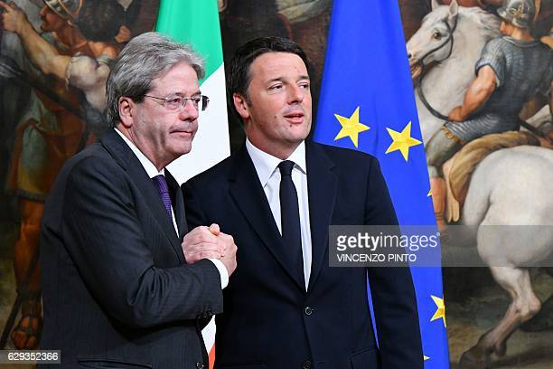 TOPSHOT Former Prime Minister Matteo Renzi and Italy's newly appointed Prime Minister Paolo Gentiloni pose during a swearing in ceremony at the...