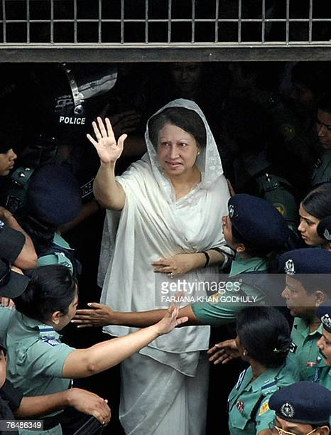 Former prime minister of Bangladesh Khaleda Zia waves as she leaves the chief magistrate court following her arrest in Dhaka 03 September 2007 Police...