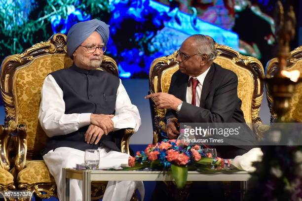Former Prime Minister of India Dr Manmohan Singh speaks to C Rangarajan former Governor of RBI during the inauguration of academic session of...
