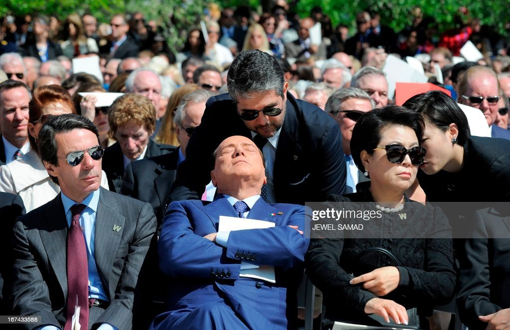 Former Prime Minister of Italy Silvio Berlusconi (C) attends the George W. Bush Presidential Center dedication ceremony in Dallas, Texas, on April 25, 2013. AFP PHOTO/Jewel Samad