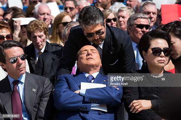 Former Prime Minister of Italy Silvio Berlusconi listens to a translator at the George W Bush Presidential Center dedication ceremony in Dallas