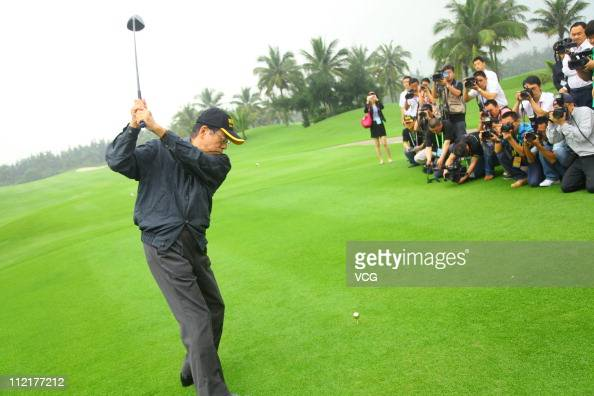 Former Prime Minister of Japan Fukuda Yasuo plays a shot during the BFA Golf Invitation 2011 as part of the Boao Forum For Asia at golf field of The...