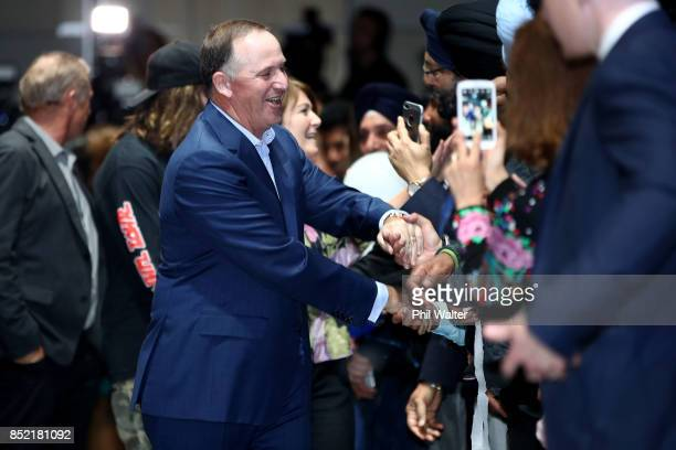Former Prime Minister of New Zealand John Key shakes hands with supporters ahead of the Electon verdict on September 23 2017 in Auckland New Zealand...