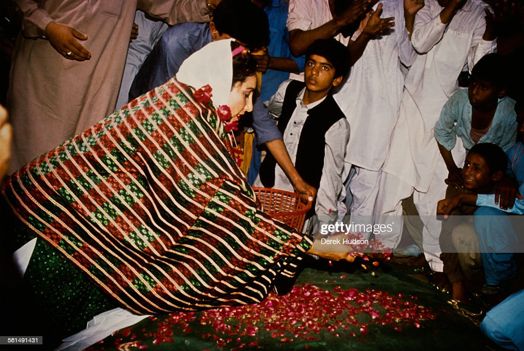 Former Prime Minister of Pakistan, Benazir Bhutto (1953 - 2007), leader of the Pakistan Peoples Party (PPP), scattering petals during the Pakistani General Election, Pakistan, 24th October 1990.
