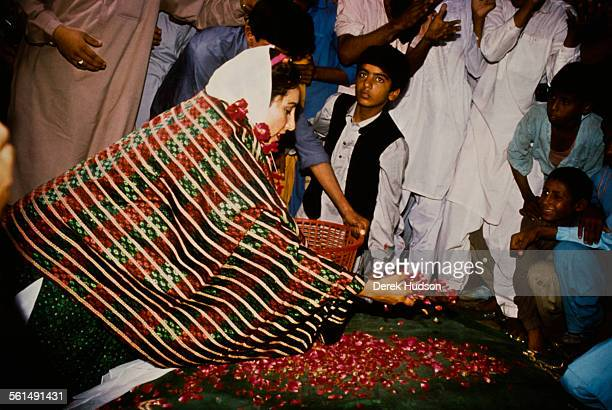 Former Prime Minister of Pakistan Benazir Bhutto leader of the Pakistan Peoples Party scattering petals during the Pakistani General Election...