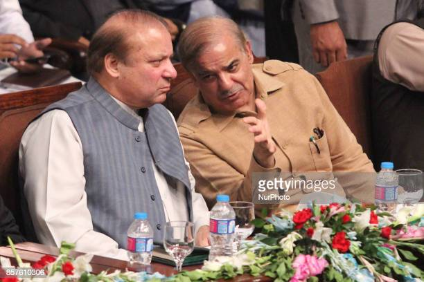 Former Prime Minister of pakistan Mian Muhammad Nawaz Sharif discussing some points with his younger brother and Chief Minister of punjab Province...