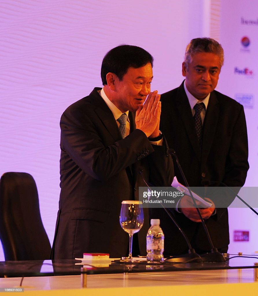 Former Prime Minister of Thailand <a gi-track='captionPersonalityLinkClicked' href=/galleries/search?phrase=Thaksin+Shinawatra&family=editorial&specificpeople=220948 ng-click='$event.stopPropagation()'>Thaksin Shinawatra</a> addresses the gathering as Rajdeep Sardesai Editor-in-chief CNN IBN looks on during the first day of the Hindustan Times Leadership Summit on November 16, 2012 in New Delhi, India.