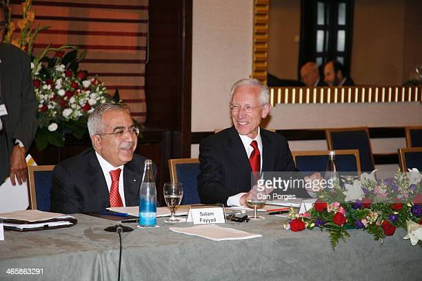 Former Prime Minister of the Palestinian Authority Salam Fayyad talks as former Governor of the Bank of Israel Professor Stanley Fischer laughs...