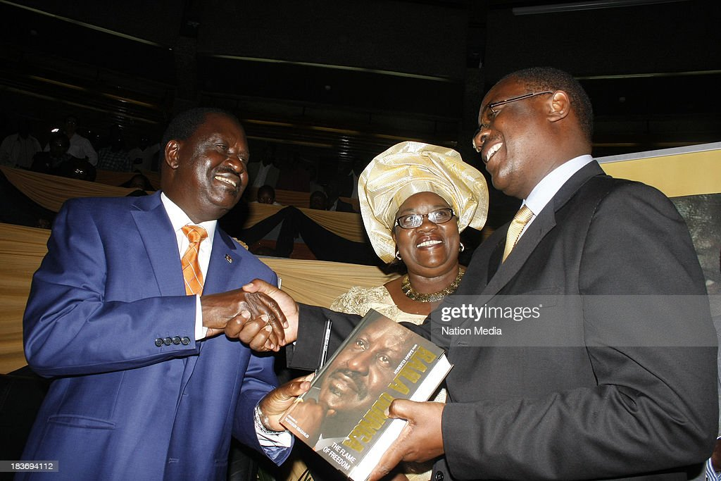 (Not for sale to The Star (Kenya), Capital FM, The People, Citizen TV, Kenya Broadcasting Corporation) Former Prime Minister Raila Odinga, Idda Odinga and Nairobi Governor Evans Kidero during the launch of his autobiography on October 6, 2013 at the KICC in Nairobi, Kenya. The Flame of Freedom takes an indepth look at the former Prime Ministers life journey; most importantly his political struggles.