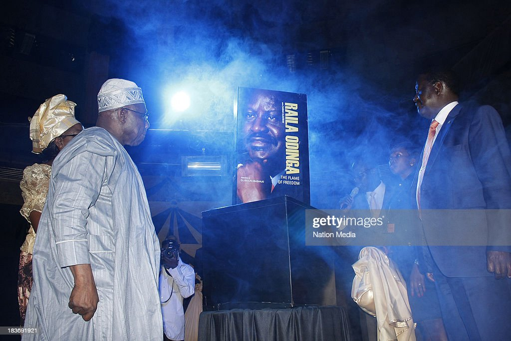 (Not for sale to The Star (Kenya), Capital FM, The People, Citizen TV, Kenya Broadcasting Corporation) Former Prime Minister Raila Odinga with former Nigerian President Olusegun Obasanjo during the launch of his autobiography on October 6, 2013 at the KICC in Nairobi, Kenya. The Flame of Freedom takes an indepth look at the former Prime Ministers life journey; most importantly his political struggles.