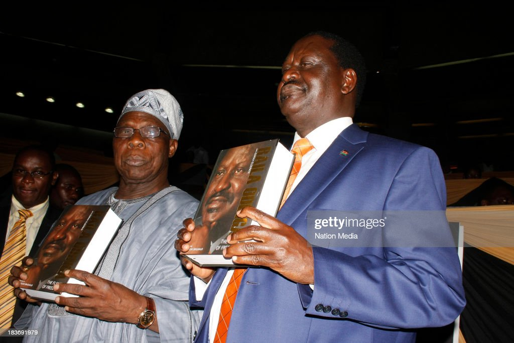 (Not for sale to The Star (Kenya), Capital FM, The People, Citizen TV, Kenya Broadcasting Corporation)Former Prime Minister Raila Odinga with former Nigerian President Olusegun Obasanjo during the launch of his autobiography on October 6, 2013 at the KICC in Nairobi, Kenya. The Flame of Freedom takes an indepth look at the former Prime Ministers life journey; most importantly his political struggles.