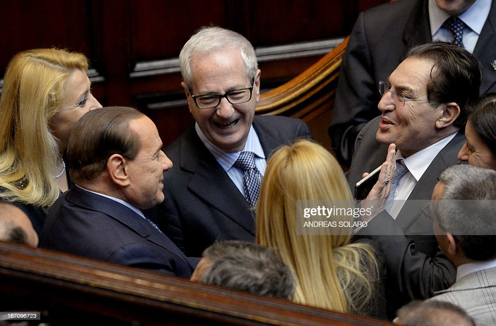 Former Prime Minister Silvio Berlusconi (L) arrives at the Italian Parliament for the election of Italy's President on April 20, 2013 in Rome. Italy's 87-year-old President Giorgio Napolitano said today he would run for a second term despite earlier ruling out the prospect, following an appeal from the main parties to help defuse an increasingly tense political crisis.'I consider it necessary to offer my availability,' Napolitano said in a statement, as bickering lawmakers prepared for a sixth round of voting in parliament that he is now expected to win by a large margin.