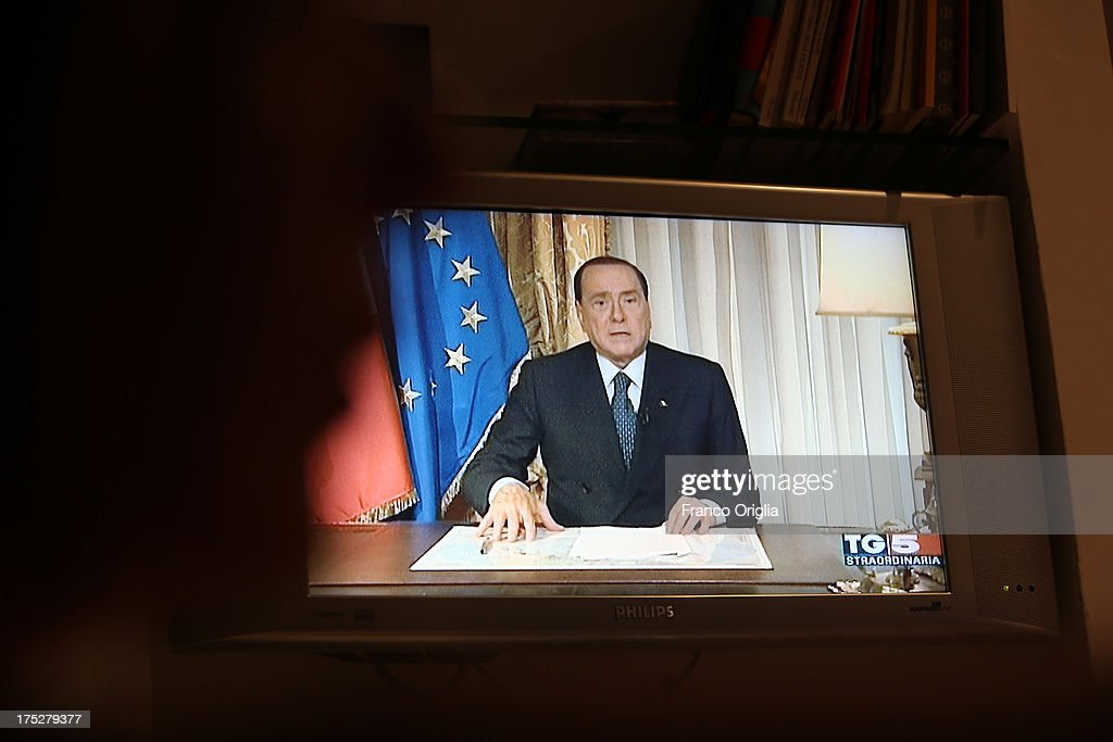 Former Prime Minister <a gi-track='captionPersonalityLinkClicked' href=/galleries/search?phrase=Silvio+Berlusconi&family=editorial&specificpeople=201842 ng-click='$event.stopPropagation()'>Silvio Berlusconi</a> holds a speech in a special edition of 'TG 5', the main breaking news broadcaster of Berlusconi's channels, in which he refers to the judges who sentenced him to prison as 'irresponsible' on August 1, 2013 in Rome, Italy. The judges of the supreme court rejected Berlusconi's final appeal against the conviction for tax fraud, sentencing him to four years in prison.