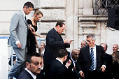 Former Prime Minister Silvio Berlusconi is flanked by his new girlfriend Francesca Pascale during a ProBerlusconi rally outside his Rome residence...