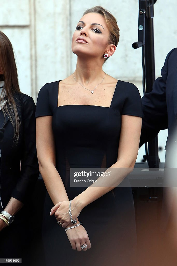 Former Prime Minister Silvio Berlusconi's girlfriend <a gi-track='captionPersonalityLinkClicked' href=/galleries/search?phrase=Francesca+Pascale&family=editorial&specificpeople=10015825 ng-click='$event.stopPropagation()'>Francesca Pascale</a> attends a Pro-Berlusconi rally organised by the People of Freedom (PDL) party outside his Rome residence, Palazzo Grazioli at Via del Plebiscito, on August 4, 2013 in Rome, Italy. Italy's Supreme court has rejected Berlusconi's final appeal against a conviction for tax fraud, upholding a four-year prison sentence for the former leader.