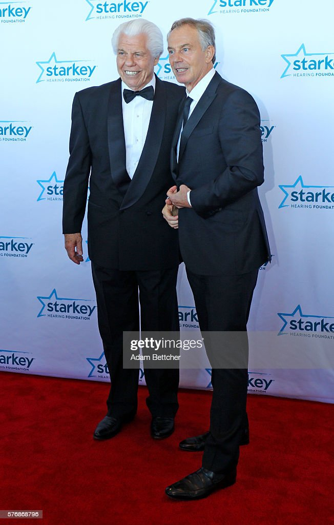 Former Prime Minister Tony Blair and Bill Austin pose on the red carpet at the 2016 Starkey Hearing Foundation 'So the World May Hear' awards gala at...