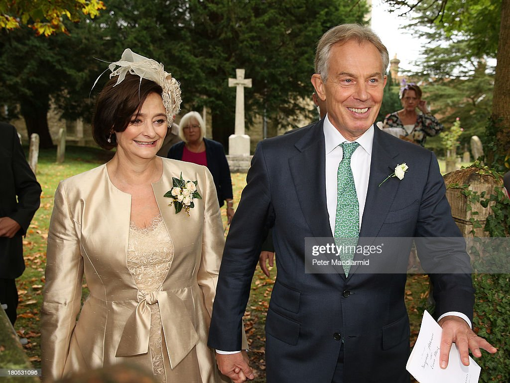 Former Prime Minister <a gi-track='captionPersonalityLinkClicked' href=/galleries/search?phrase=Tony+Blair&family=editorial&specificpeople=118622 ng-click='$event.stopPropagation()'>Tony Blair</a> and his wife Cherie leave All Saints Church after attending the wedding of their son Euan Blair to Suzanne Ashman on September 14, 2013 in Wotton Underwood, England. Euan Blair, son of former Prime Minister <a gi-track='captionPersonalityLinkClicked' href=/galleries/search?phrase=Tony+Blair&family=editorial&specificpeople=118622 ng-click='$event.stopPropagation()'>Tony Blair</a> is getting married at a church near his father's house in Buckinghamshire.