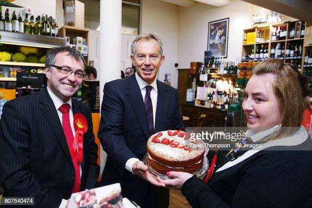 Former Prime Minister Tony Blair is given a cake by Alex Haigh watched by Phil Woolas the Labour candidate for Oldham East and Saddleworth during a...
