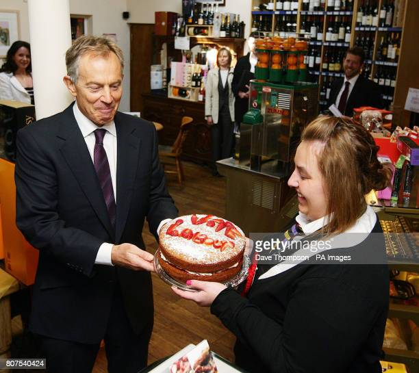 Former Prime Minister Tony Blair is given a cake by Alex Haigh during a visit to the Rams Head Inn in Denshaw in support of Phil Woolas the Labour...