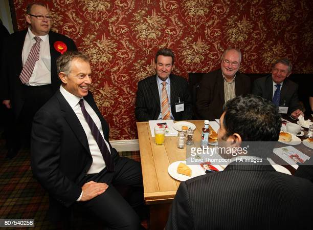 Former Prime Minister Tony Blair talks with local businessmen during a visit to the Rams Head Inn in Denshaw to campaign on behalf of Phil Woolas the...