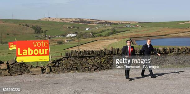 Former Prime Minister Tony Blair talks with Phil Woolas the Labour candidate for Oldham East and Saddleworth during a visit to the Rams Head Inn in...