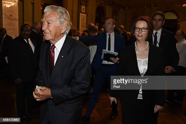 Former Prime Ministers Bob Hawke and Julia Gillard leave the state memorial service for former Australian Prime Minister Gough Whitlam at Sydney Town...