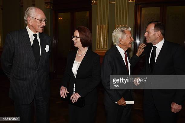 Former Prime Ministers Malcolm Fraser Julia Gillard Bob Hawke and current Prime Minister Tony Abbott mingle following the state memorial service for...