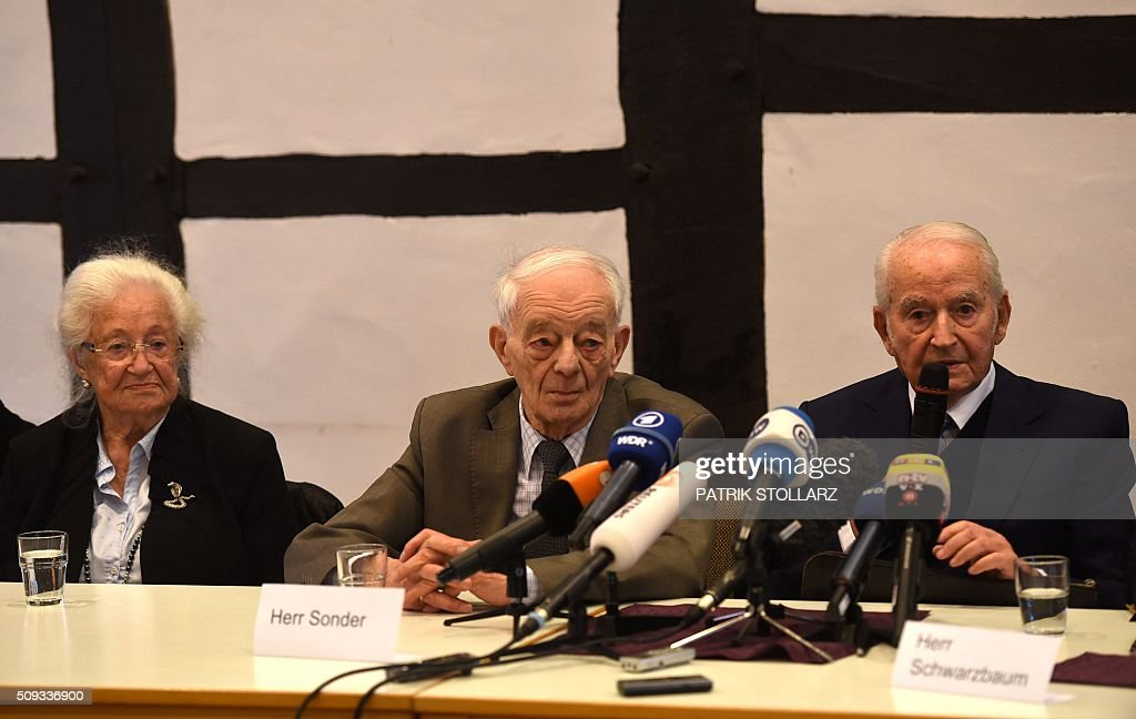 Former prisoners of Auschwitz extermination camp, (L-R) Erna de Vries, Justin Sonder and Leon Schwarzbaum take part in a press conference in Detmold, western Germany, on February 10, 2016 ahead of a trial of a former SS man Reinhold Hanning. Reinhold Hanning, 93, faces court in the western town of Detmold from Thursday, charged with at least 170,000 counts of accessory to murder in his role as a former guard at the camp in occupied Poland. / AFP / PATRIK STOLLARZ