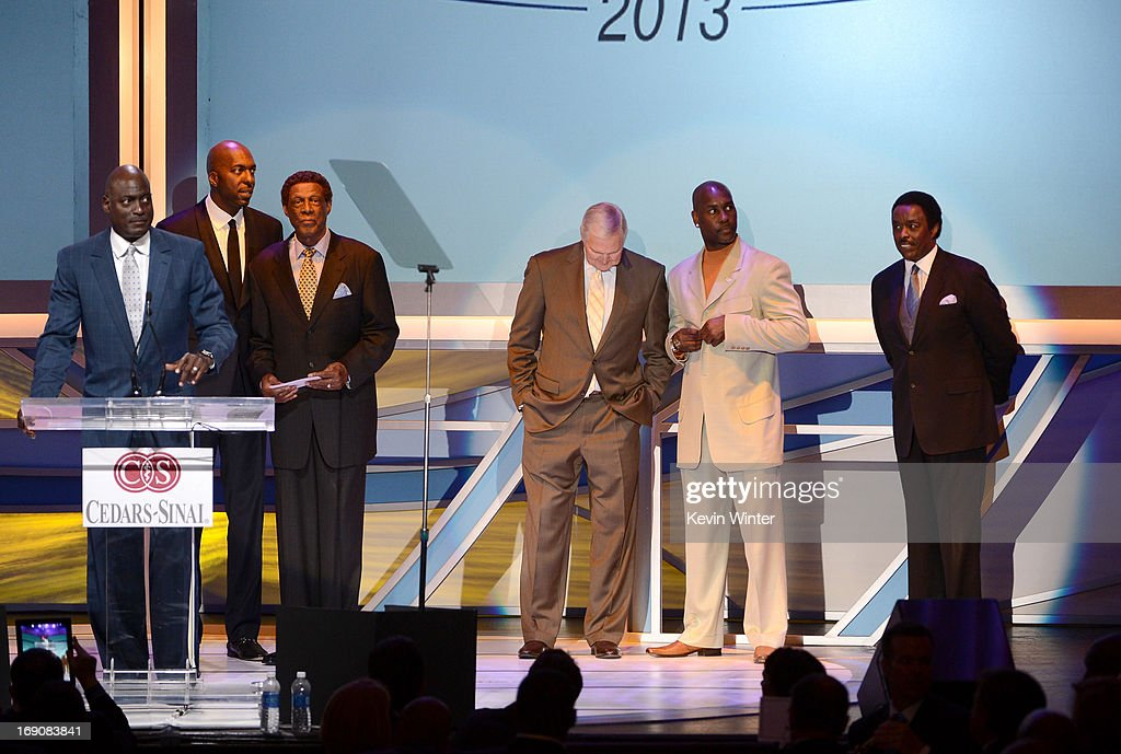 Former pro basketball players Michael Cooper, John Salley, Elgin Baylor, Jerry West and Gary Payton and sportscaster Jim Hill stand onstage at the 28th Anniversary Sports Spectacular Gala at the Hyatt Regency Century Plaza on May 19, 2013 in Century City, California..