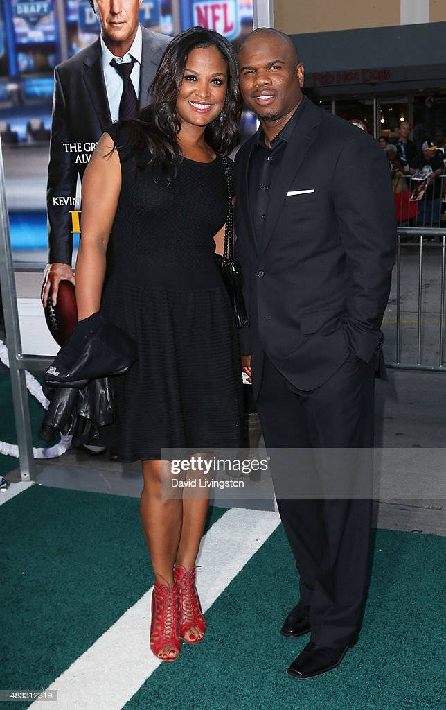 Former pro boxer Laila Ali and husband former NFL player Curtis Conway attend the premiere of Summit Entertainment's 'Draft Day' at the Regency...