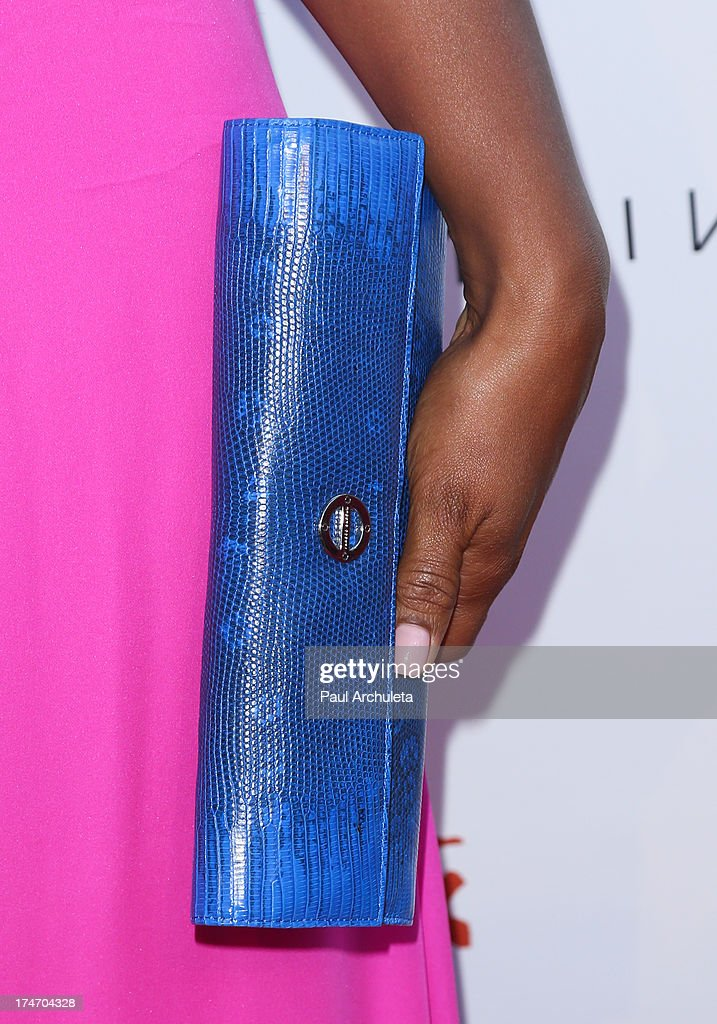 Former Pro Boxer Laila Ali (Handbag Detail) attends the 15th annual DesignCare charity event on July 27, 2013 in Malibu, California.