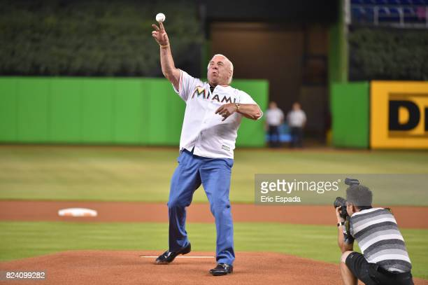 Former pro wrester Ric Flair throws out the first pitch before the start of the game between the Cincinnati Reds and the Miami Marlins at Marlins...