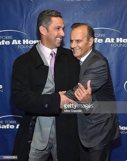 Former professional baseball player Jorge Posada and former professional baseball player/manager Joe Torre attend Joe Torre's Safe At Home...