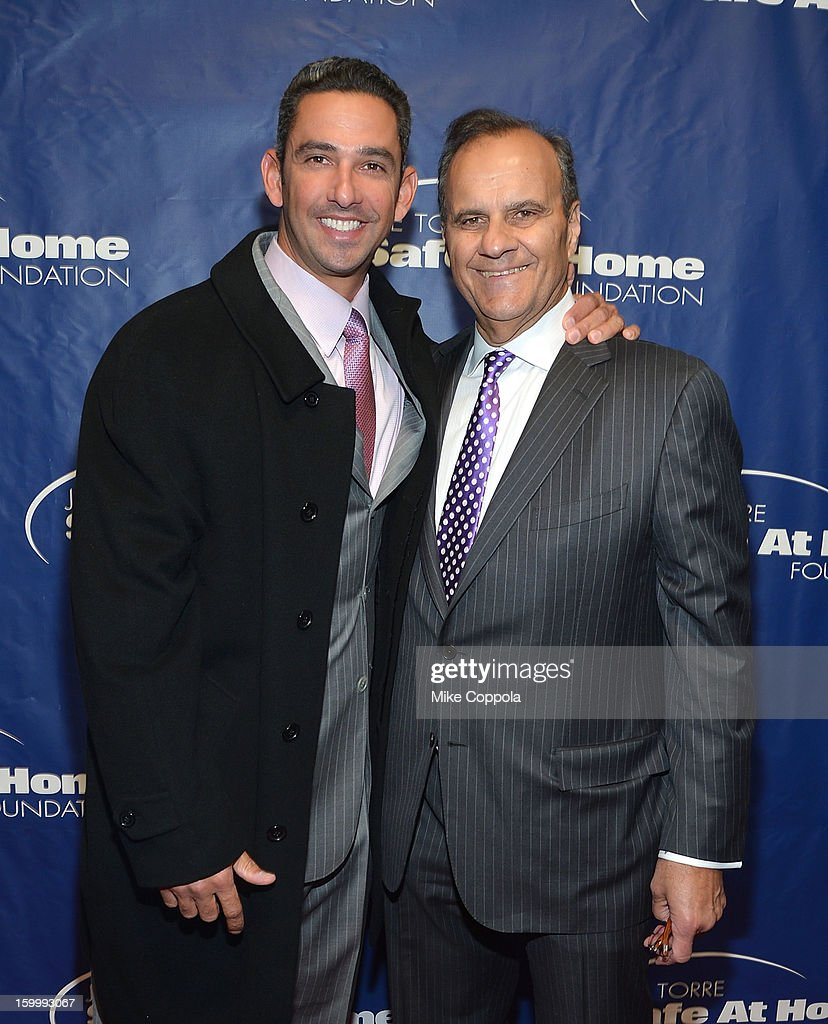 Former professional baseball player Jorge Posada and former professional baseball player/manager Joe Torre attend Joe Torre's Safe At Home Foundation's 10th Anniversary Gala at Pier 60 on January 24, 2013 in New York City.