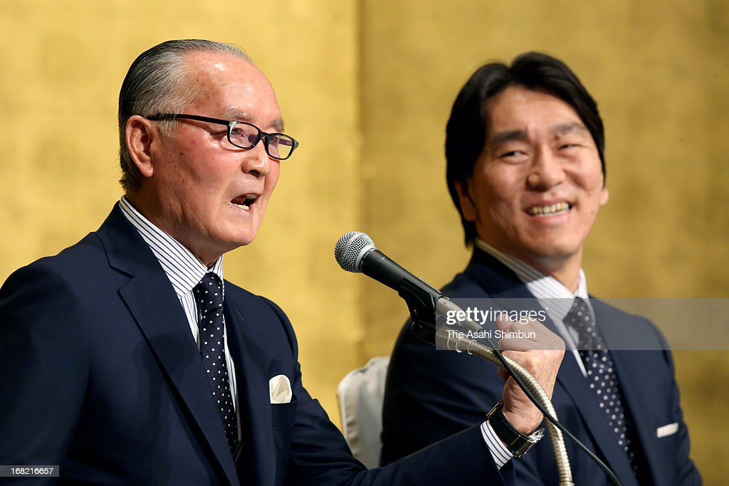 Former professional baseball player Shigeo Nagashima speaks while Hideki Matsui listens during a press conference on their People's Honor Award on...