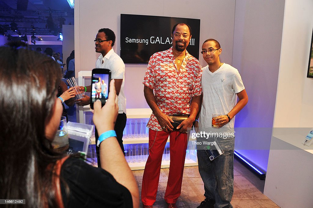 Former professional basketball player and Hall-of-Famer <a gi-track='captionPersonalityLinkClicked' href=/galleries/search?phrase=Walt+Frazier&family=editorial&specificpeople=211195 ng-click='$event.stopPropagation()'>Walt Frazier</a> (C) attends the Samsung Galaxy S III Launch hosted by Ashley Greene at Skylight Studios on June 20, 2012 in New York City.