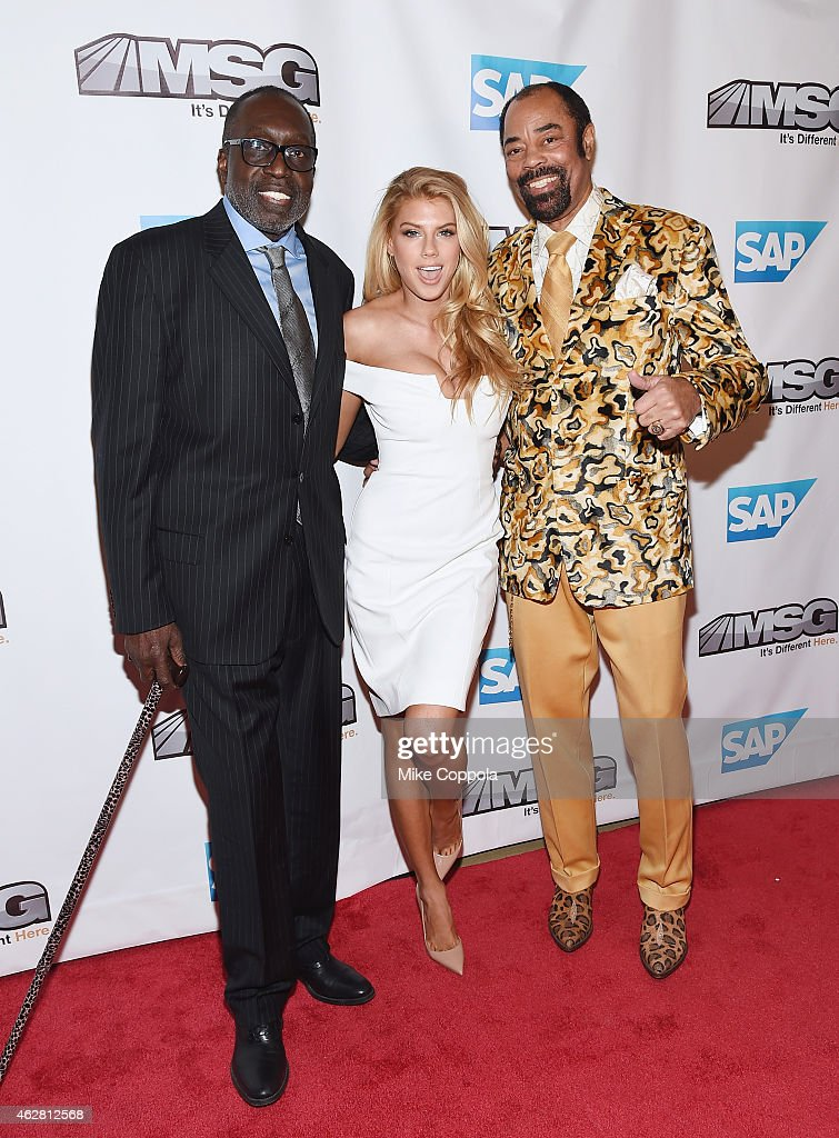 Former professional basketball player Earl 'The Pearl' Monroe, model <a gi-track='captionPersonalityLinkClicked' href=/galleries/search?phrase=Charlotte+McKinney&family=editorial&specificpeople=13559762 ng-click='$event.stopPropagation()'>Charlotte McKinney</a>, former professional basketball player Walter 'Clyde' Frazier attend MSG Networks Original Programming Party at Madison Square Garden on February 5, 2015 in New York City.