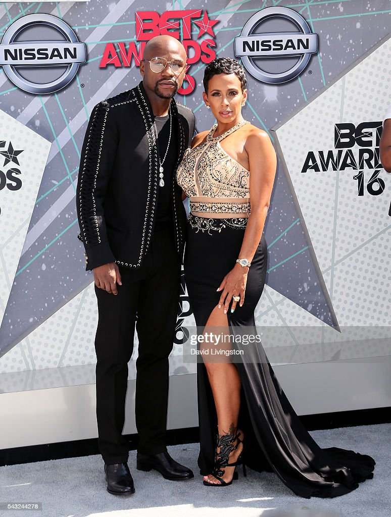 Former professional boxer Floyd Mayweather (L) and guest attend the 2016 BET Awards at Microsoft Theater on June 26, 2016 in Los Angeles, California.