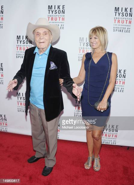 Former Professional Boxer Jake LaMotta and his fiancee Denise Baker attend the 'Mike Tyson Undisputed Truth' Broadway Opening Night at Longacre...