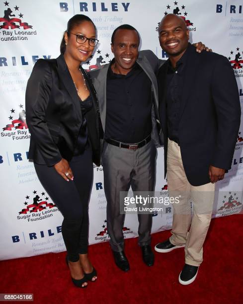 Former professional boxer Laila Ali former professional boxer Sugar Ray Leonard and professional football player Curtis Conway attend the 8th Annual...