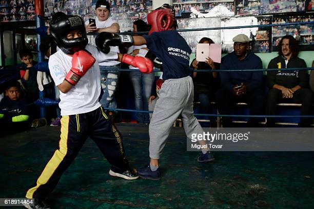 Former professional boxer Lennox Lewis and spanish retired professional footballer Carles Puyol looks on a children boxing combat during the Laureus...