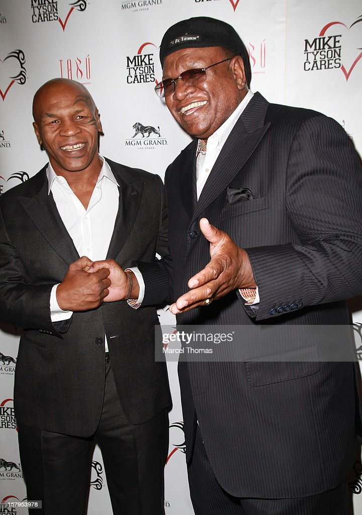 Former professional boxer Mike Tyson and comedian George Wallace attend the Launch Party for 'Mike Tyson Cares Foundation' at Tabu Ultra Lounge at MGM Grand on December 7, 2012 in Las Vegas, Nevada.