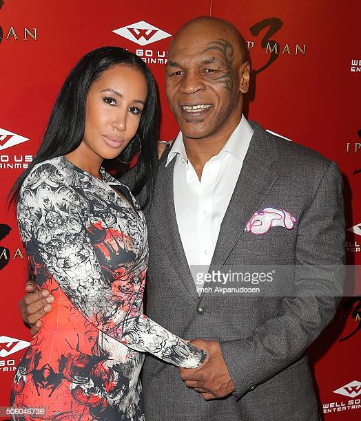 Former professional boxer Mike Tyson and wife Lakiha Spicer attend the premiere of Well Go USA Entertainment's 'Ip Man 3' at Pacific Theatres at The...