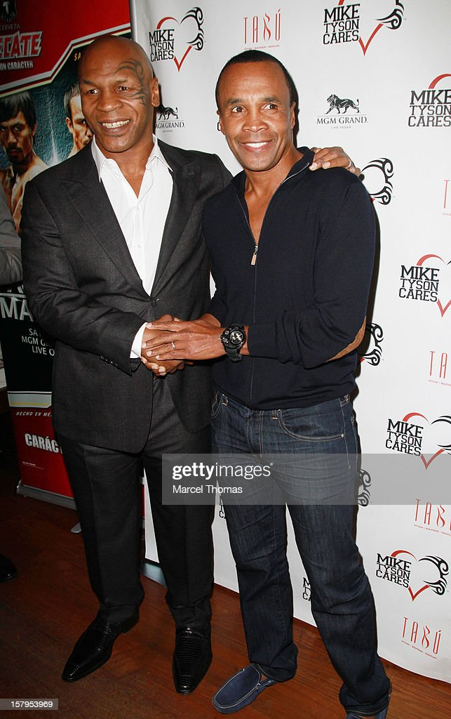 Former professional boxers Mike Tyson and Sugar Ray Leonard attend the Launch Party for 'Mike Tyson Cares Foundation' at Tabu Ultra Lounge at MGM Grand on December 7, 2012 in Las Vegas, Nevada.