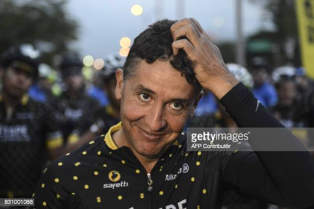 Former professional cyclist and 2008 Tour de France champion Spaniard Carlos Sastre is pictured before the start of 'L'Etape Colombia by Le Tour de...