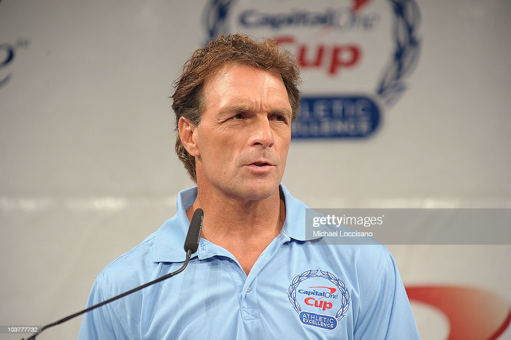 Former professional football player Doug Flutie addresses the press during the Capital One Division 1 College Sports Award launch at The Times Center...