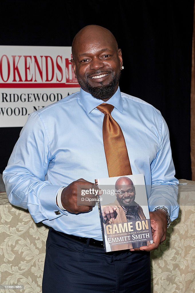 Former professional football player Emmitt Smith promotes his book 'Game On Find Your Purpose Pursue Your Dream' at the Bookends Bookstore on...