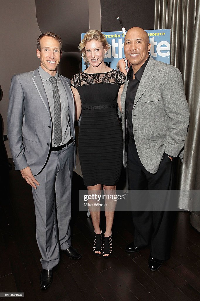 Former professional football player Hines Ward (R) and winners of the 2012 IRONMAN World Championship, Pete Jacobs (L) and Leanda Cave (C) at the 21st Annual Endurance LIVE awards gala presented by REFUEL | got chocolate milk? at Club Nokia on February 23, 2013 in Los Angeles, California.