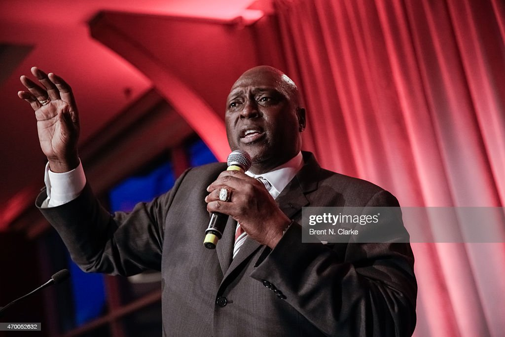 Former professional football player Ottis 'OJ' Anderson conducts a live auction from the stage during the Scribbles To Novels 10th Anniversary Gala held at Pier Sixty at Chelsea Piers on April 16, 2015 in New York City.