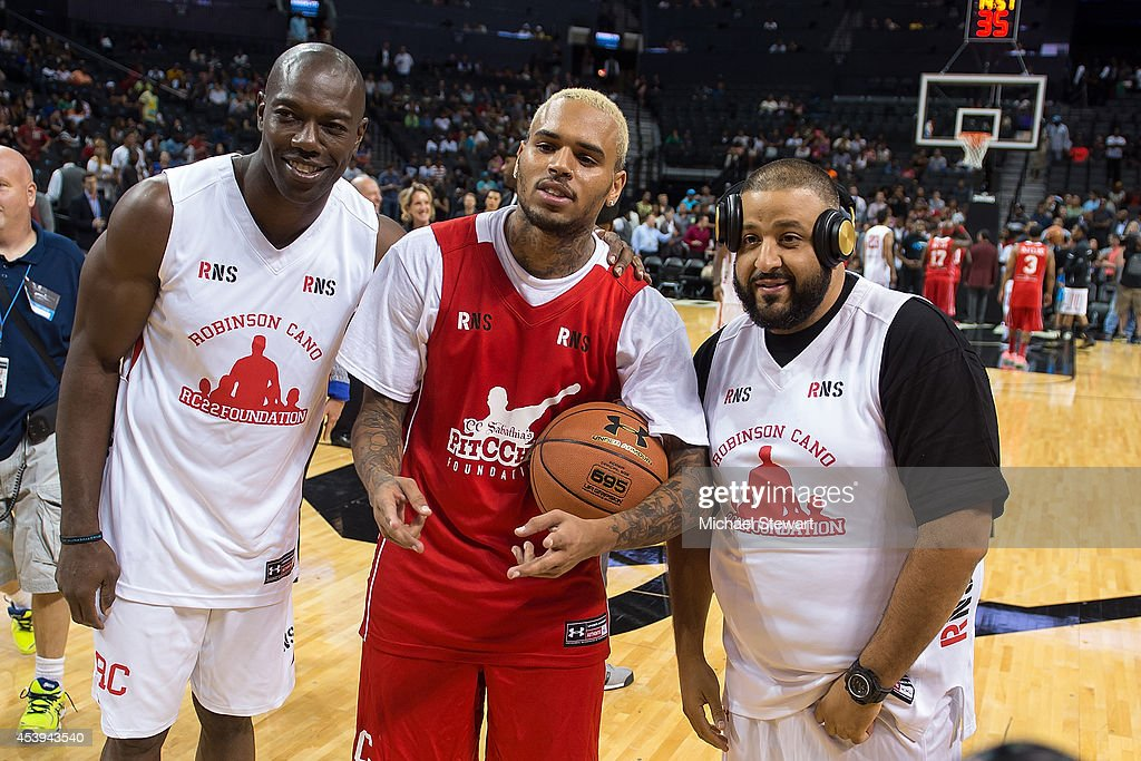 Former professional football player Terrell Owens, rapper Chris Brown and DJ Khaled attend the 2014 Summer Classic Charity Basketball Game at Barclays Center on August 21, 2014 in New York City.